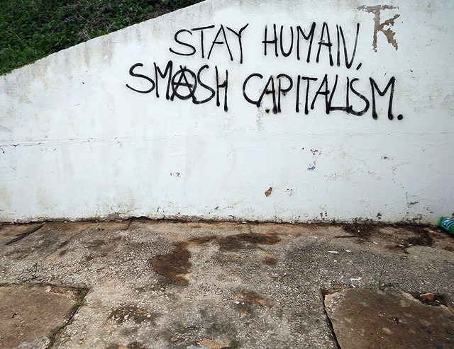Ada Wanders/Włóczykijada. Writing on the wall in Lagos: Stay Human. Smash Capitalism.